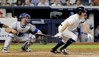 New York Yankees left fielder Brett Gardner (11) gets an RBI on a fielders choice against the Toronto Blue Jays during the sixth inning at Yankee Stadium. — Reuters