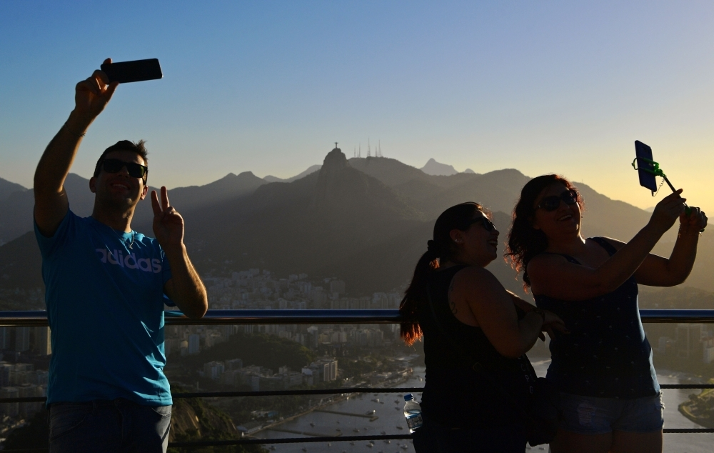 Tourists take selfies at Sugarloaf Hill in Rio de Janeiro, Brazil, in this June 7, 2019 file photo. — AFP