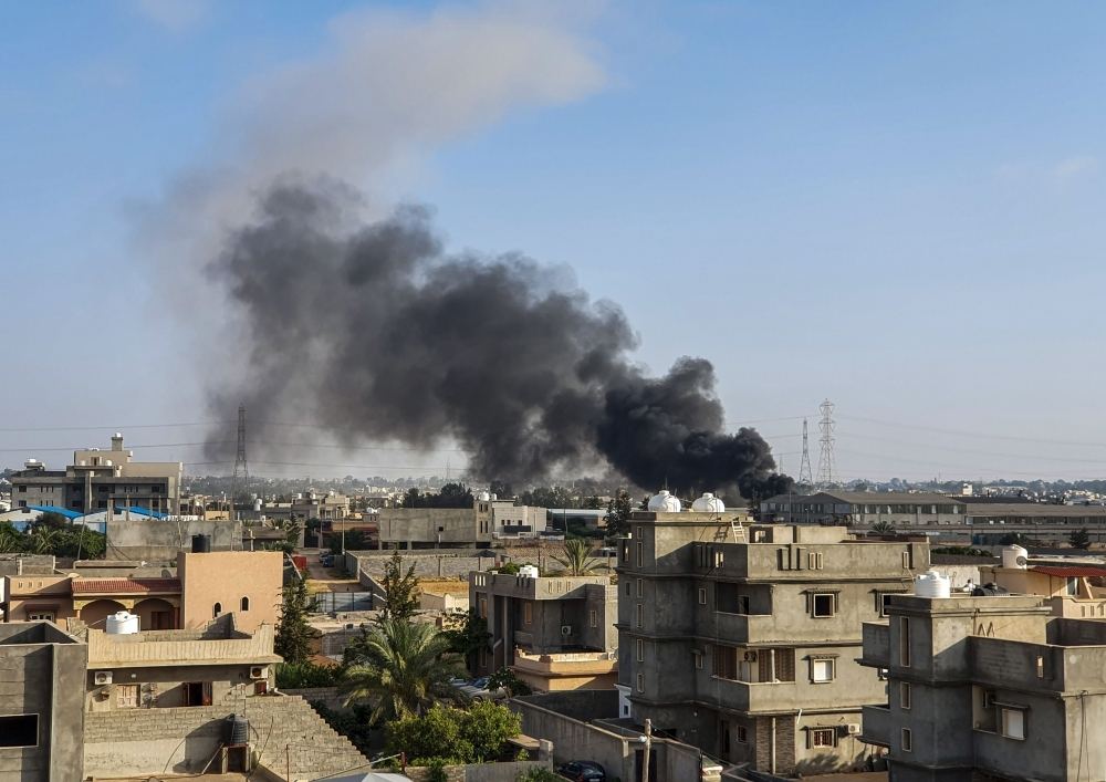 Smoke plumes rise in Tajoura, south of the Libyan capital Tripoli, following a reported airstrike by forces loyal to Gen. Khalifa Haftar. — AFP