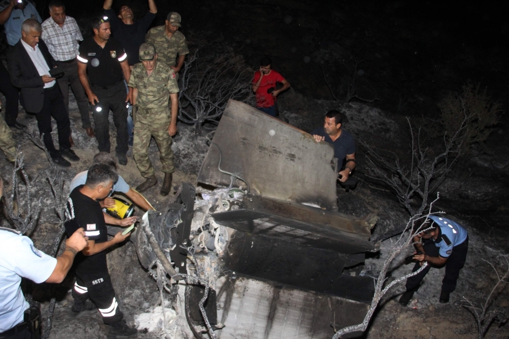 Turkish Cypriot police and inspectors check the remains of what officials said was a suspected Russian missile that exploded overnight on Monday, in the northern part of the divided island, during an Israeli aerial raid in Syria. — AFP