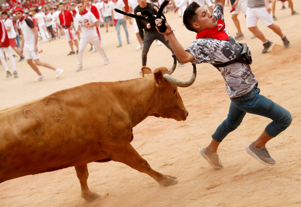 A man is hit in the bullring during the running of the bulls at the San Fermin festival in Pamplona, Spain, on Sunday. -Reuters