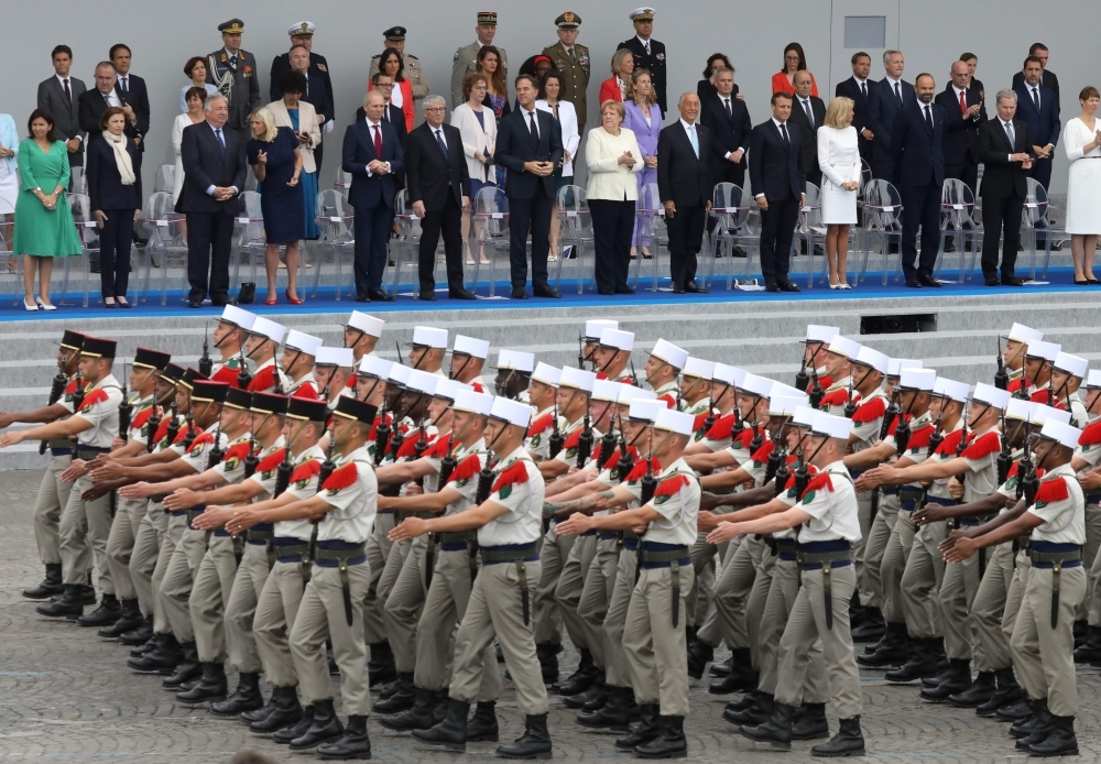 Soldiers of the Foreign legion march in Paris on Sunday. -AFP