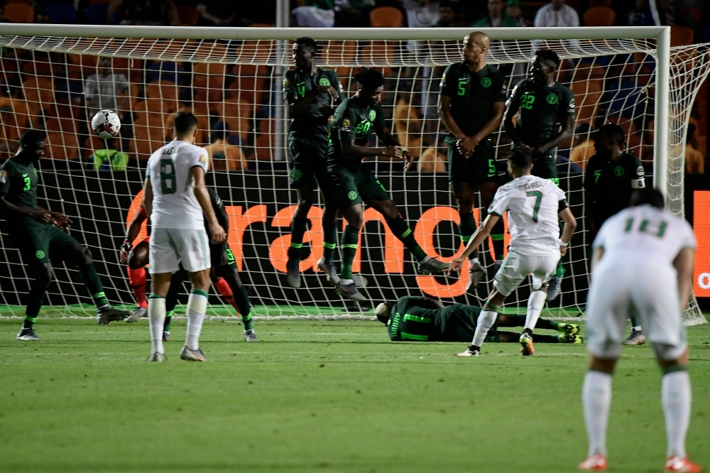 Algeria's forward Riyad Mahrez (R) scores from a free-kick during the 2019 Africa Cup of Nations semifinal football match between Algeria and Nigeria at the Cairo International stadium in Cairo, on Sunday. — AFP