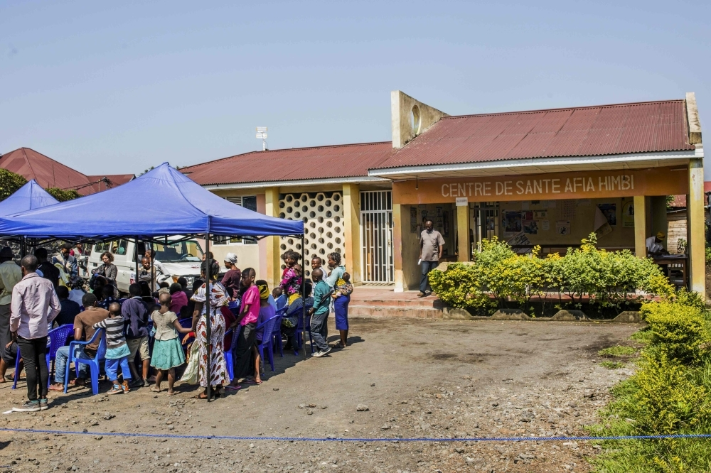 Patients wait outside the Afia Himbi Health Center in Goma, D.R. Congo, on Monday. — AFP