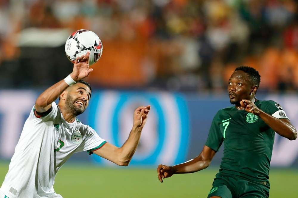 Algeria's forward Riyad Mahrez (L) vies for the ball with Nigeria's forward Ahmed Musa during the 2019 Africa Cup of Nations semifinal football match between Algeria and Nigeria at the Cairo International stadium in Cairo, on Sunday. — AFP