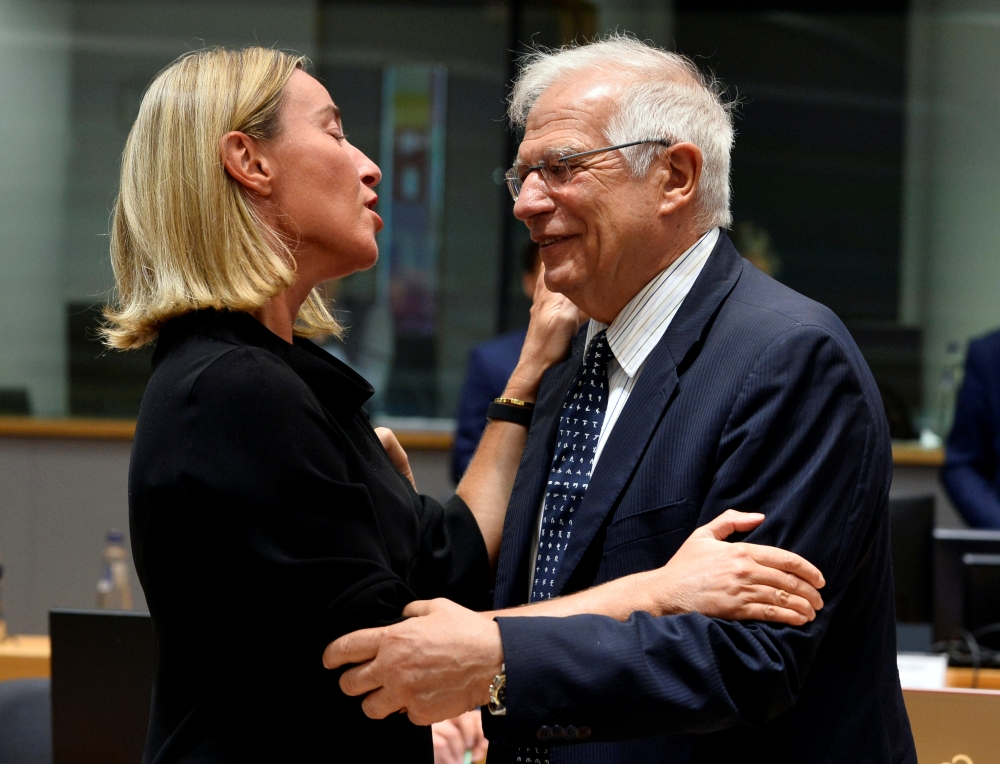 European Union Foreign Policy Chief Federica Mogherini and Spanish Foreign Minister Josep Borrell attend a EU Foreign Ministers meeting in Brussels, Belgium on Monday. — Reuter