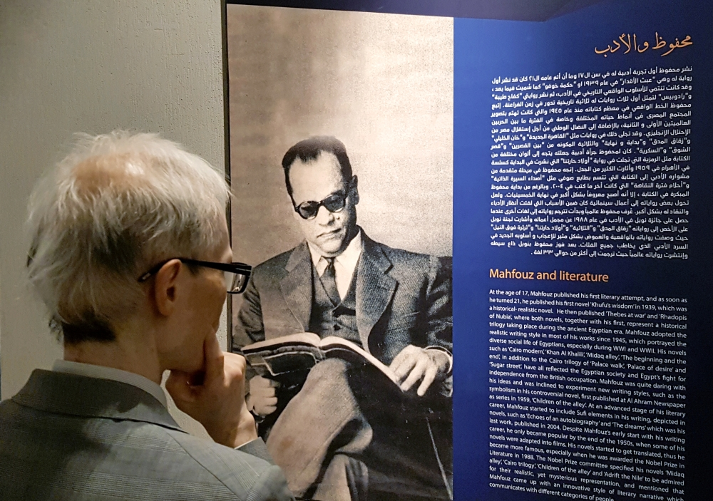 Foreign visitor reads the biography of the late Egyptian writer Naguib Mahfouz after the official opening of the museum in Cairo, Egypt, on Sunday. — Reuters