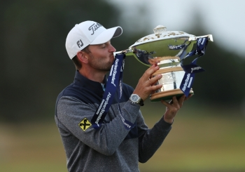 Austria's Bernd Wiesberger celebrates with the trophy after winning the Scottish Open at The Renaissance Club, North Berwick, Britain, on Sunday. — Reuters
