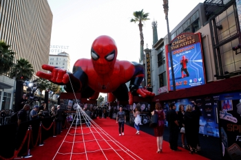A giant spider-man balloon is seen above the red carpet along a closed Hollywood Blvd. outside the TCL Chinese Theater for the World Premiere of Marvel Studios'