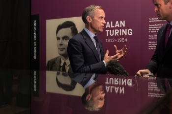 Mark Carney, governor of the Bank of England, is interviewed after attending at a press conference announcing the concept design for the new Bank of England fifty pound banknote, featuring mathematician and scientist Alan Turing, during the presentation at the Science and Industry Museum in Manchester, north-west England on Monday. — AFP