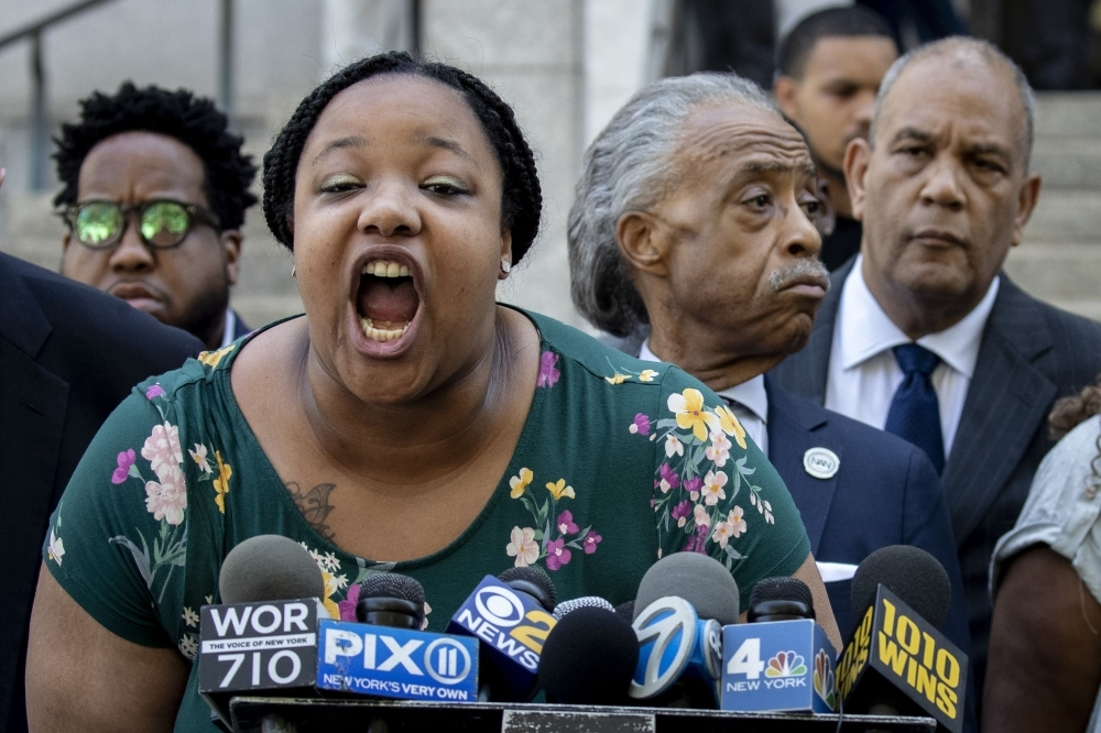 Emerald Garner, daughter of the late Eric Garner, speaks during a press conference outside the US Attorney's office following a meeting with federal prosecutors on Tuesday in the Brooklyn borough of New York City. -AFP
