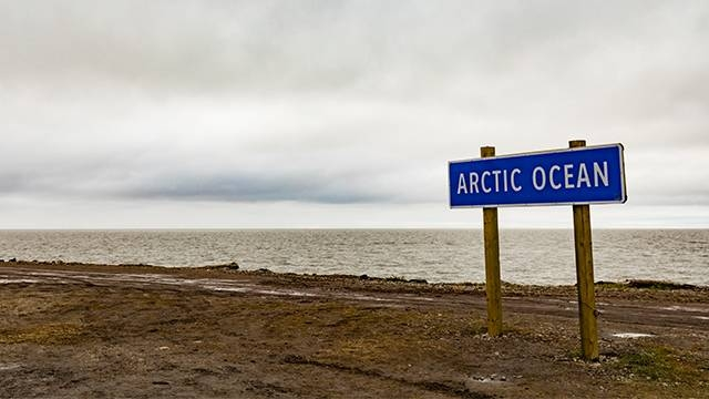 A signpost marks the Arctic Ocean at the shore of Beaufort Sea in Tuktoyaktuk, Northwest Territories, Canada. –Courtesy photo
