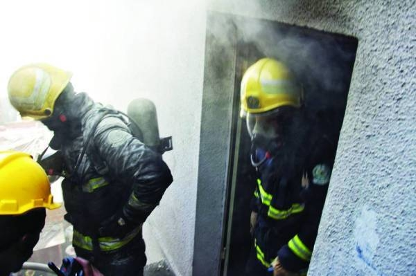 Civil Defense personnel containing the fire.