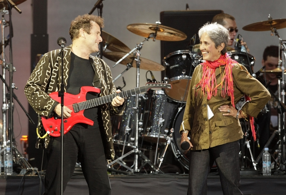 In this file photo taken on June 27, 2008 South African singer-songwriter Johnny Clegg (L) and US singer Joan Baez perform during the 46664 concert in honor of Nelson Mandela's 90th birthday in Hyde Park, central London. — AFP