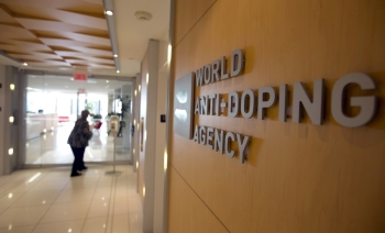 A woman walks into the head office of the World Anti-Doping Agency (WADA) in Montreal, Quebec, Canada in this Nov. 9, 2015 file photo. — Reuters