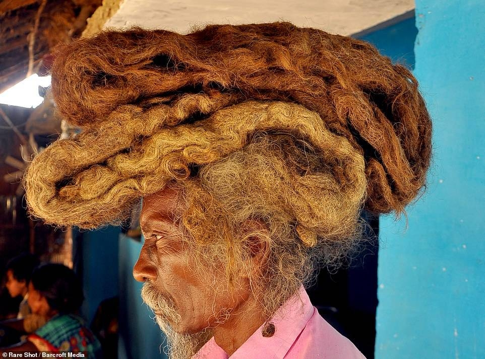 Tuddu, 63, from India's Bihar state, wears his six-foot-long mat of hair on top of his head like a turban wrapped in a white cloth.
