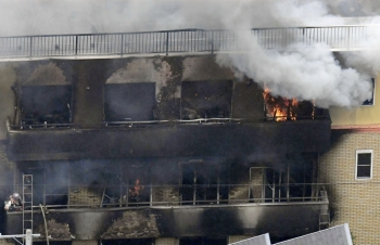 An aerial view shows smoke and flame rise from the three-story Kyoto Animation building which was torched in Kyoto, western Japan, on Thursday. — Reuters