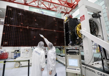 A technician looks at a solar panel on the Inmarsat S-Band/Hellas-Sat 3 satellite in the clean room facilities of the Thales Alenia Space plant in Cannes, France, in this Feb. 3, 2017 file photo. — Reuters