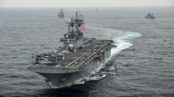 This US Navy file photo taken on March 7, 2016  shows the amphibious assault ship USS Boxer (LHD 4) as it transits the East Sea during Exercise Ssang Yong 2016. The US military shot down an Iranian drone on Thursday that came within 1,000 yards of one of its naval vessels in the Strait of Hormuz, President Donald Trump said.— AFP