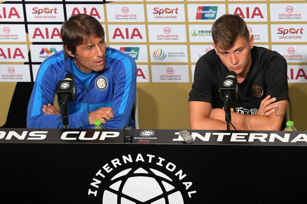 Inter Milan's manager Antonio Conte (L) and player Nicolo Barella attend a press conference in Singapore on Friday ahead of the team's International Champions Cup football match against Manchester United. — AFP
