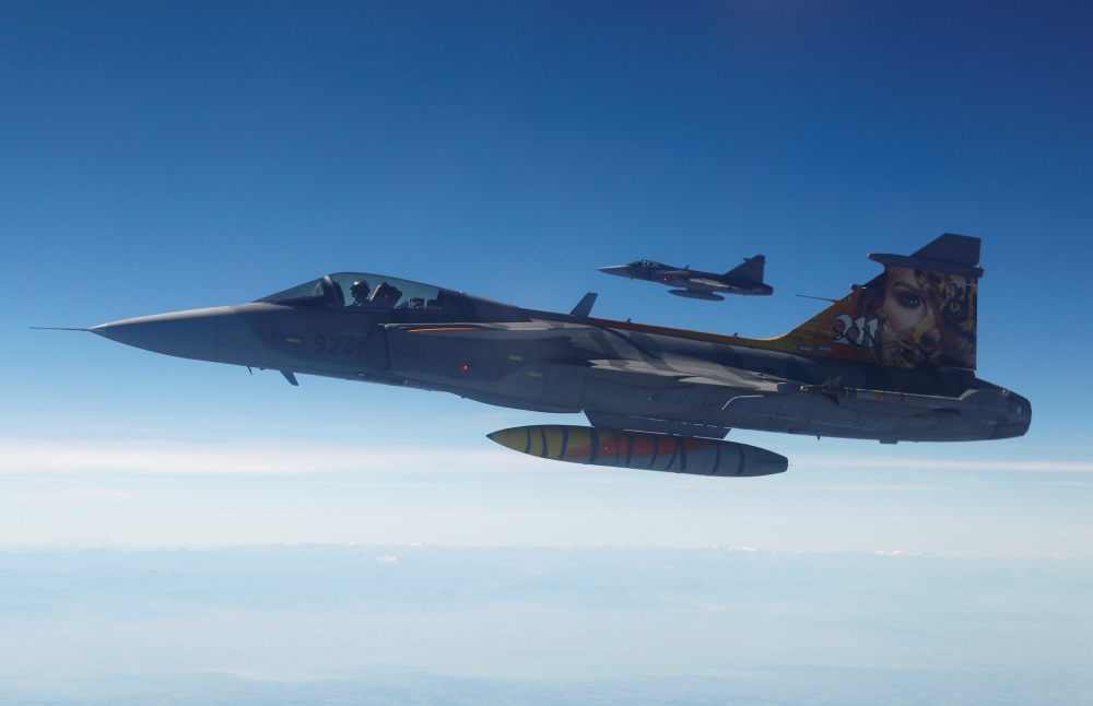 Two Czech Gripen fighter planes demonstrate a flight interception of a Belgian air force transport plane over the Czech Republic as part of NATO drills in this in this Sept. 12, 2018 file photo. — Reuters