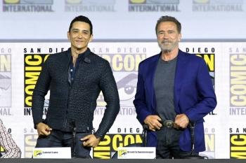 Gabriel Luna and Arnold Schwarzenegger speak at the