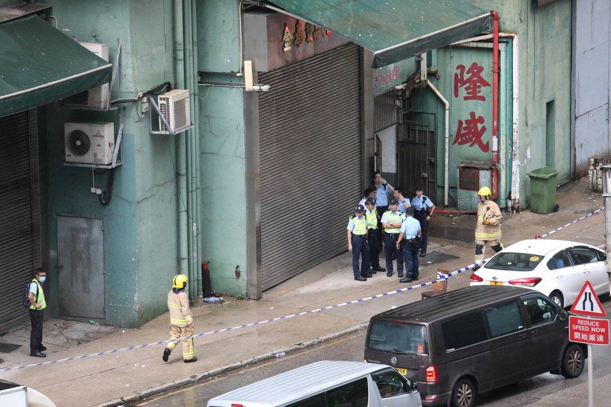 Police officers at the factory site in Tsuen Wan, Hong Kong. –Courtesy photo