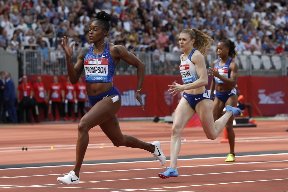 Jamaica's Elaine Thompson (L) competes in the women's 200m event during the the IAAF Diamond League Anniversary Games athletics meeting at the London Stadium in London, on Saturday. — AFP