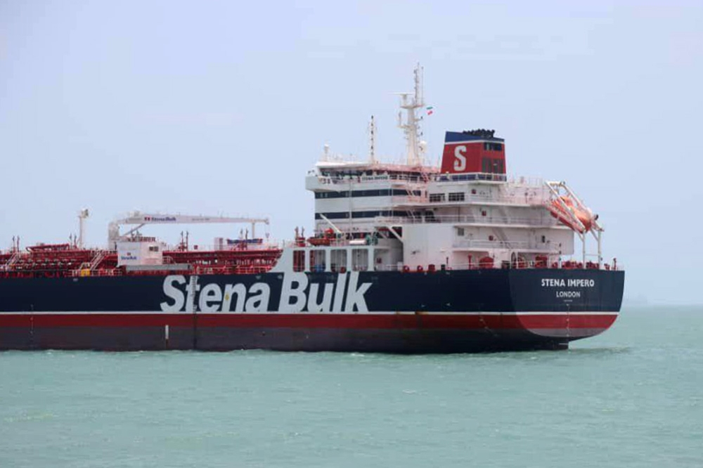 This handout picture released by Tasnim News Agency, shows British-flagged tanker Stena Impero anchored in Bandar Abbas in southern Iran. A British-flagged tanker seized by Iran is now at anchor off the port of Bandar Abbas with all its crew aboard after colliding with a fishing boat. — AFP