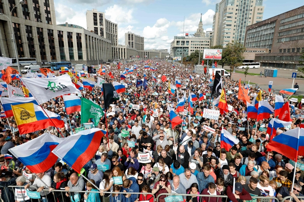 Demonstrators take part in a rally to support opposition and independent candidates after authorities refused to register them for September elections to the Moscow City Duma, Moscow, on Saturday. — AFP