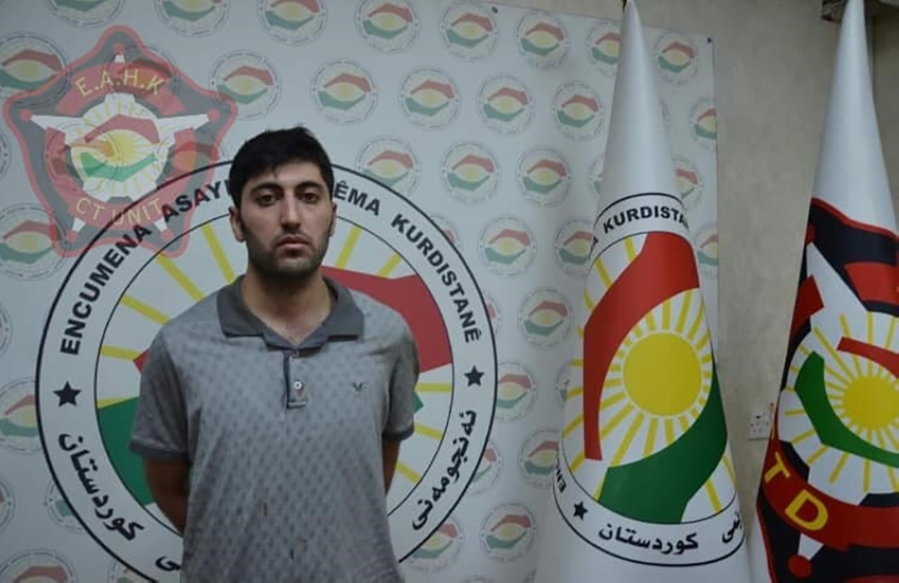 This handout photograph released by the Kurdistan Region Counterterrorism Unit on Saturday, shows 27-year-old Mazloum Dag, a Kurdish man from Turkey who was identified as the suspected shooter in the murder of a Turkish diplomat, standing at an undisclosed location in Erbil. — AFP