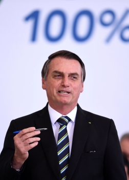 Brazilian President Jair Bolsonaro gestures during a ceremony to commemorate the first 200 days of his administration at Planalto Palace in Brasilia, on July 18, 2019. -AFP photo