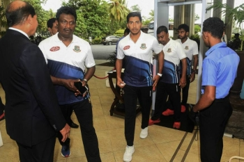 Bangladesh cricketer Soumya Sarkar (C) arrives with teammates in Colombo, on Saturday. — AFP