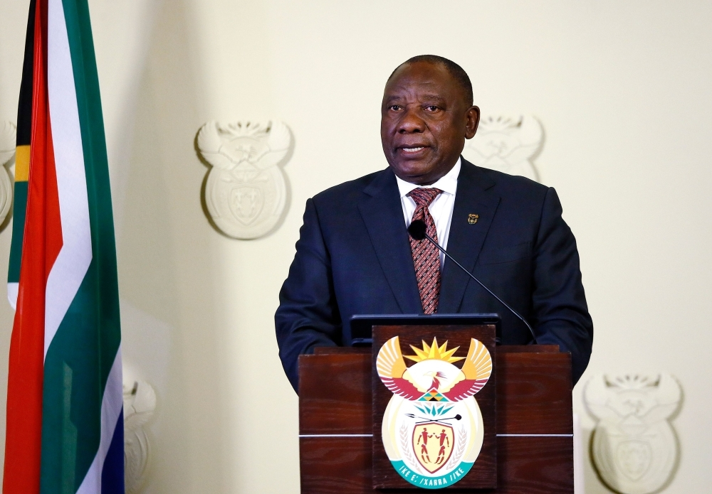 South African President Cyril Ramaphosa gives a press conference at The Union Buildings on Sunday in Pretoria, South Africa.  Ramaphosa said he will challenge in court a watchdog body's