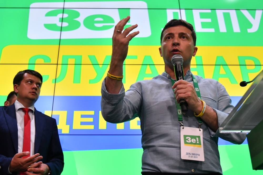 Ukrainian President Volodymyr Zelensky gives a speech at his Servant of the People party's election headquarters in Kiev on Sunday, following a day of polling in the country's parliamentary election. — AFP