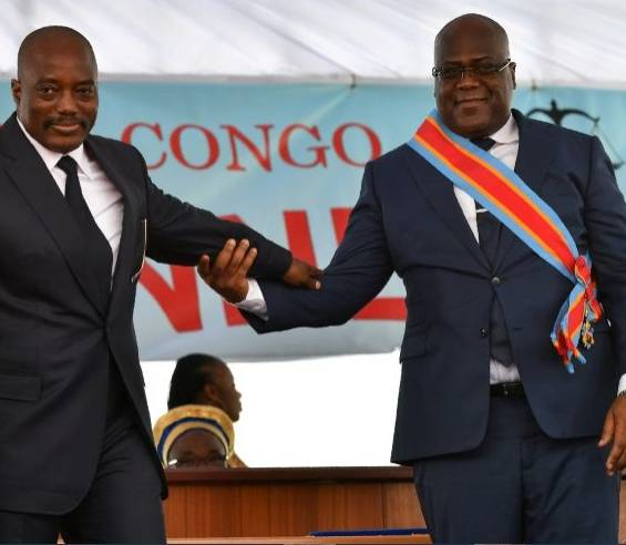 During his inauguration DR Congo's new president, Felix Tshisekedi, (R) walks off the podium with outgoing leader Joseph Kabila in Kinshasa in January 2019. –AFP photo