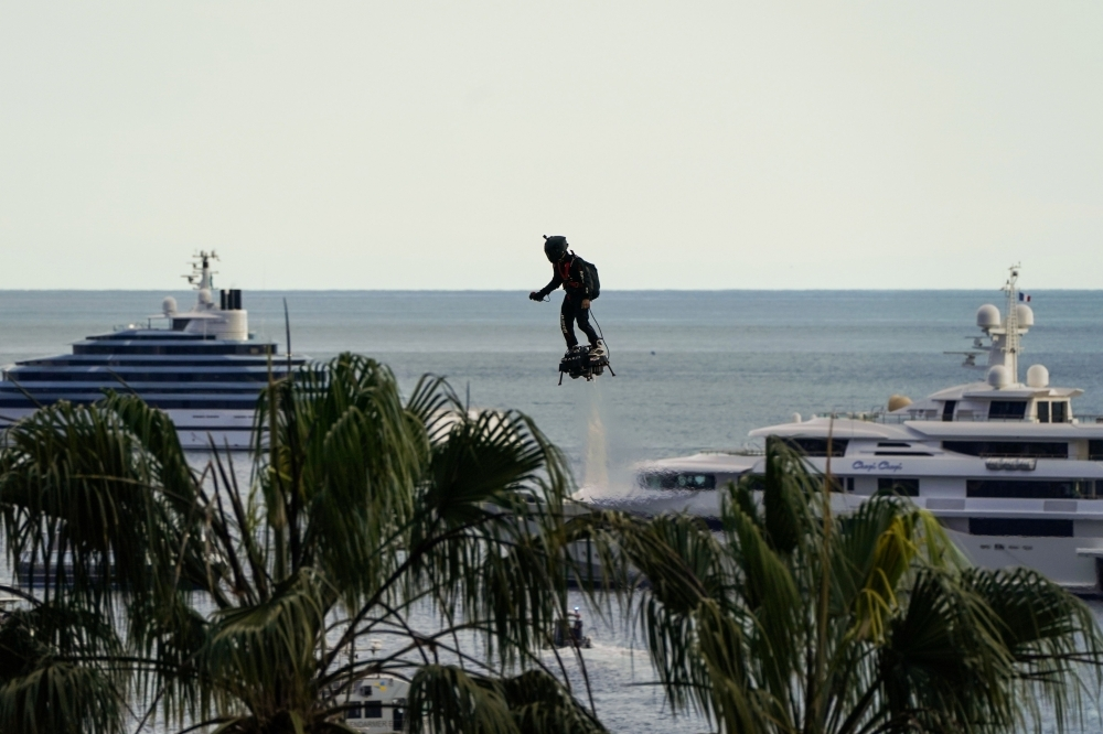 In this file photo taken on May 15, 2018, Zapata CEO Franky Zapata flies a jet-powered hoverboard or