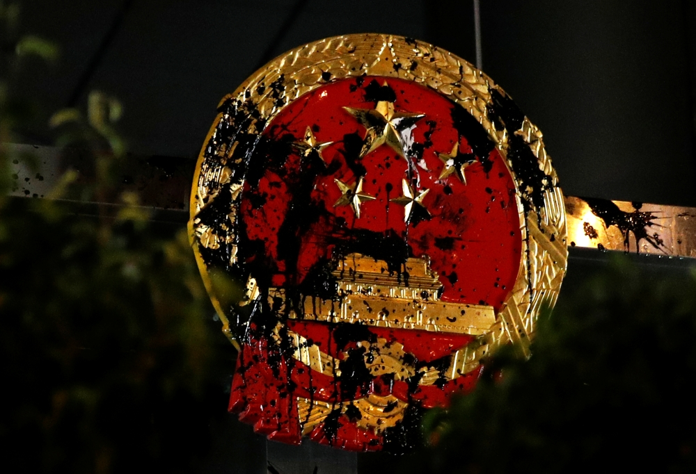 The National Emblem of the People's Republic of China is seen vandalized on the Chinese Liaison Office after a march to call for democratic reforms, in Hong Kong, China, in this July 21, 2019 file photo. — Reuters