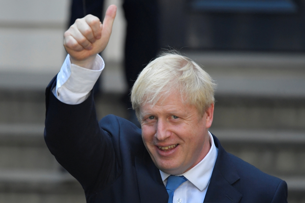 Boris Johnson, leader of the Britain's Conservative Party, leaves the party's headquarters in London, Britain, on Tuesday. — Reuters
