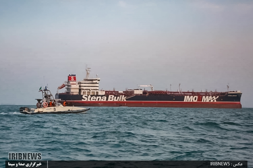An image grab taken from a broadcast by Islamic Republic of Iran Broadcasting (IRIB) on Monday shows Iranian Revolutionary Guards in speedboats patrolling a tanker Stena Impero as it's anchored off the Iranian port city of Bandar Abbas.  — AFP