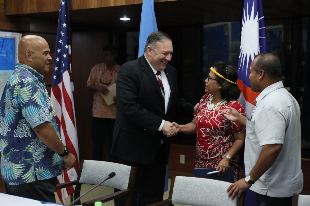US Secretary of State Mike Pompeo talks after a news conference with Micronesia's President David Panuelo (L), Marshall Islands' President Hilda Heine (2nd R) and Palau's Vice President Raynold Oilouch (R) in Kolonia on Monday. -AFP