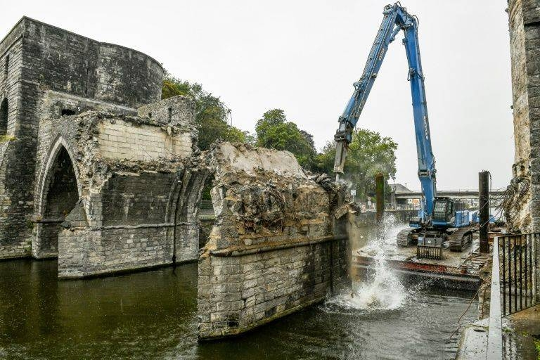 Workers press ahead with demolishing the arches which were rebuilt after World War II when British troops blew up the original medieval bridge over the Scheldt at Tournai. –Courtesy photo