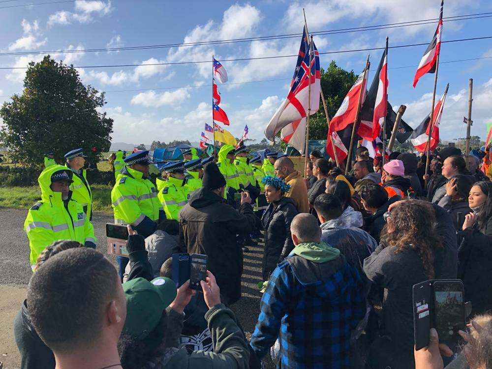 Protest leader Pania Newton (C) is seen at a protest at Ihumatao, Auckland, in this undated handout photo released on Sunday. -Reuters