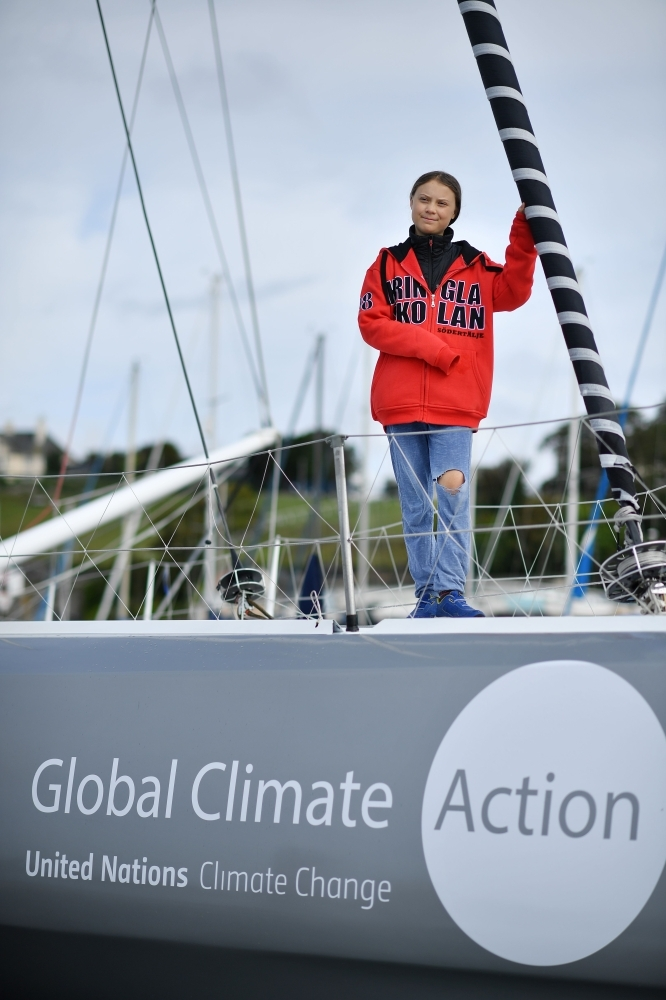 Swedish climate activist Greta Thunberg poses for a photograph during an inteview with AFP onboard the Malizia II sailing yacht at the Mayflower Marina in Plymouth, southwest England, on Tuesday ahead of her journey across the Atlantic to New York where she will attend the UN Climate Action Summit next month.  -AFP