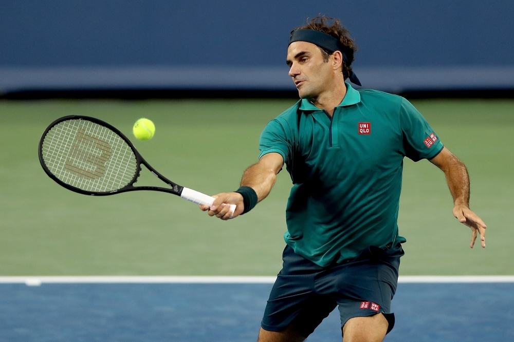 Roger Federer of Switzerland returns a shot to Juan Ignacio Londero of Argentina during the Western & Southern Open at Lindner Family Tennis Center in Mason, Ohio, on Tuesday. — AFP