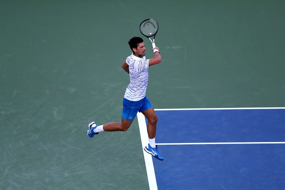 Novak Djokovic of Serbia returns a shot to Sam Querrey of the United States during Day 4 of the Western and Southern Open at Lindner Family Tennis Center in Mason, Ohio, on Tuesday. — AFP