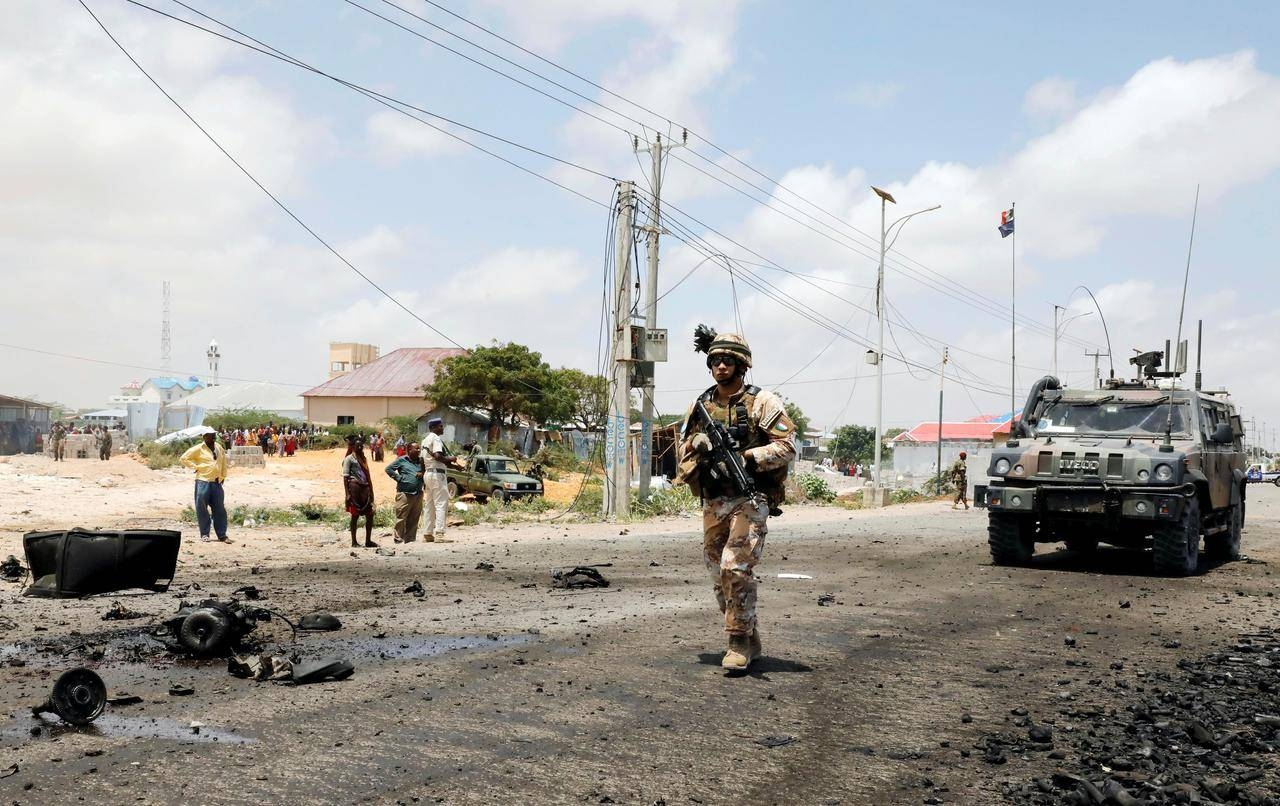 A soldier patrols the road as the damage is assessed after militant group Al-Shabaab hit a European Union armored convoy in Mogadishu, Somalia, in this Oct. 1, 2018 file photo. — Reuters