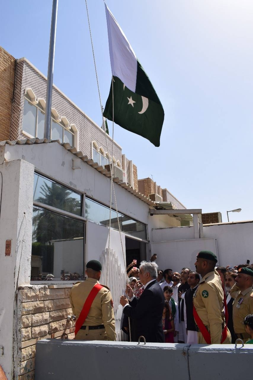 Consul General of Pakistan Shehryar Akbar Khan hoists the Pakistani flag to mark the Independence Day at the premises of the Pakistan Consulate in Jeddah on Wednesday. — Courtesy photo