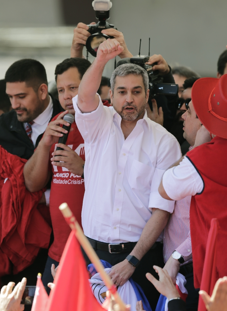 Paraguay's President Mario Abdo Benitez gestures as he meets supporters in Asuncion, Paraguay, August 13, 2019. -Reuters