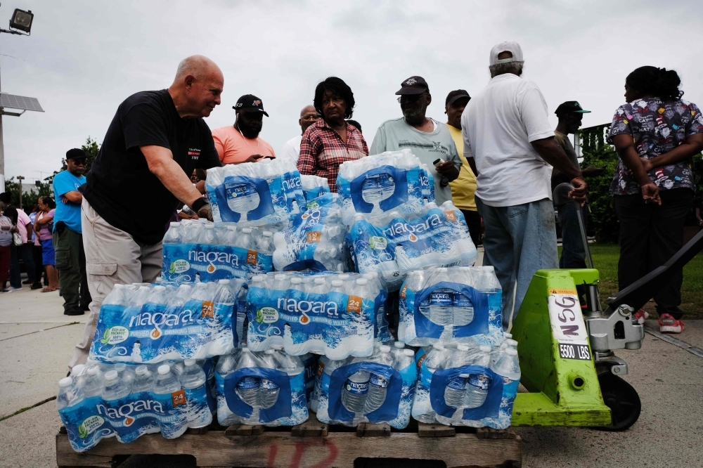 A pallet of bottled water is delivered to a recreation center in Newark, New Jersey, in this Aug. 13, 2019 file photo. — AFP